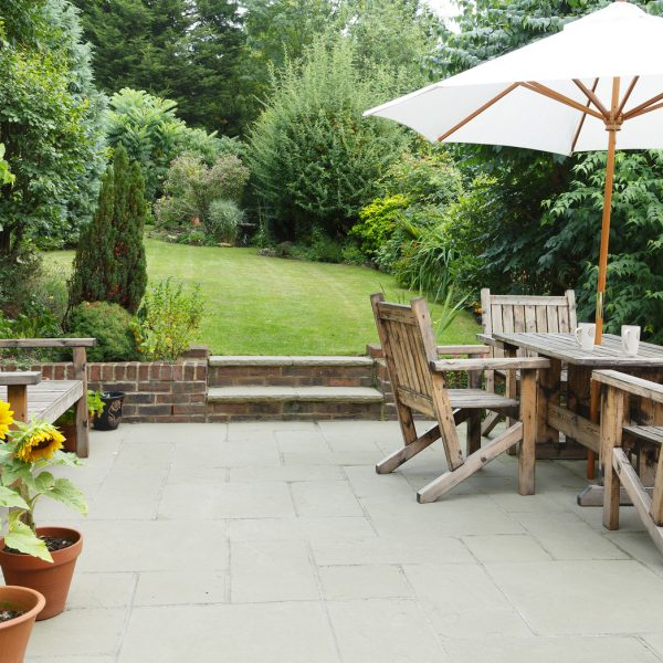 London Garden In Summer With Patio, Wooden Garden Furniture And